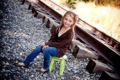 adorable girl by train tracks