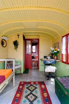 caravan  ~ love the rich colors---I love the wood ceiling and siding but I would prefer it in more of a white wash I think