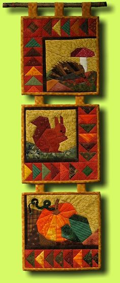 """""""Autumn pictures"""" ... quilt by Regina Grewe ... squirrel, hedgehog and pumpkin representing autumn /fall"""