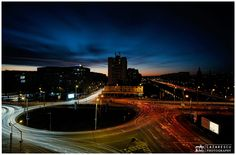 """City lights by night - Rush hour traffic by night. City of Iasi in part of the NE of Romania.  Gear settings:  1. Fuji X-E2 2. Fuji 14mm f/2.8 setting at f8 3. NiSi 100 mm Aluminium Filter Holder V3 Foundation Kit 4. Nisi ND1000 """"Z"""" 5. Nisi Square Soft Reverse GND8 (0.9)  Time exposure: 15 minutes"""