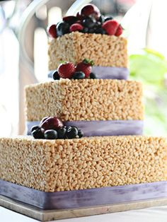 Tami...This is cute-Let Sam do it for her wedding!!!  Why didn't I do this for my wedding cake??  What could be better than a tower of rice crispy treats?  Wish there was a way to do gender reveal rice crispy treats!