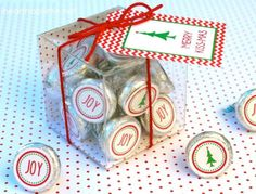 """Such a cute idea! Merry Kissmas tag and kiss stickers. You can use the free printables on stickers on Avery full-sheet labels or design your own on Avery 1"""" round labels."""