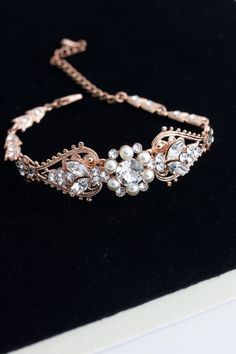 This beautiful handmade bridal bracelet showcases sparkling Swarovski crystals and lustrous swarovski pearl set on attractive vintage filigree.