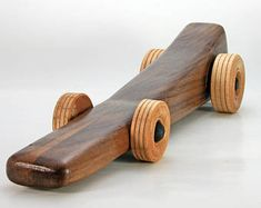 UNIQUE HANDMADE TOY CARS My Wooden Toy Car collection is designed and made in the USA by Vyto Bendoraitis. Each item is handcrafted one at a time using select hardwoods. All items are sanded smooth with all edges rounded over, and finished by hand. Sealed with non-toxic shellac with a final application of organic beeswax, and hand-rubbed to a beautiful silky smooth finish. Durable, rugged, handcrafted toys that children can play with - generation to generation. HANDMADE ITEM Materials…