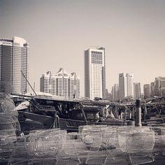 Abu Dhabi harbour - orestegaspari.com #abudhabi #uae #abudhabiimages #simplyabudhabi #visitabudhabi #photographabudhabi #emirates #amazingabudhabi #we_abudhabi #inabudhabi #discoverabudhabi #myabudhabi #harbour #fish #fishingnet #boatfishing #boat #skyscrapers #skyline #wealth #poverty