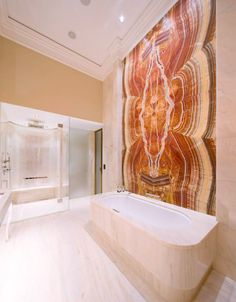 SolidNature.com : Hyatt Park Vienna. All rooms with a different type of onyx, all bookmatched. In the spa there is a curved bookmatched onyx, it looks amazing. #bathroom #spa #hotel #interior #design #marble #onyx