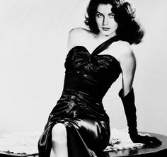 Eva Gardner looking great in a really beautiful what looks like satin dress ~! ~ !