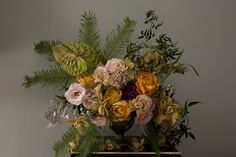 Entriken Studio - peach, gold floral arrangement