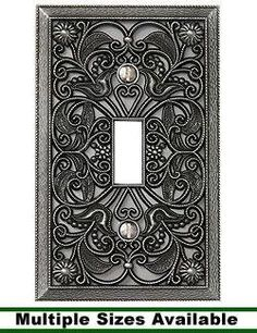 amerelle filigree 2 toggle wall plate antique brass antique brass and walls