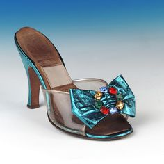 Mule made by H & M Rayne, 1953, featuring a clear vamp and multi-coloured cut glass gem.