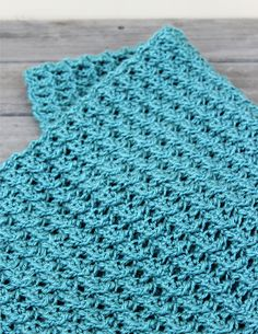 The Endless Sea Blanket uses a unqiue new stitch technique to create a beautifully textured, yet lightweight fabric with great drape! It is made to measure, so you may make to any dimensions, work to your own gauge and use yarn and hook of choice with excellent results. The pattern is an easy 1-row repeat, making the blanket reversible (identical on both sides).