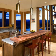 Fox Run 13 is a #contemporary spin on a traditional ranch house, nestled among three side of #mountains and the #RoaringForkRiver in #Aspen, #Colorado. Designed by David Johnston Architects, this home features our Pharos #Pendants in the #kitchen! #niche #nichemodern #pendantlighting #lighting #glass #handmade #beacon #newyork #madewithlove #iheartniche #design #interiordesign