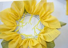 how to make a yellow burlap flower wreath                                                                                                                                                                                 More