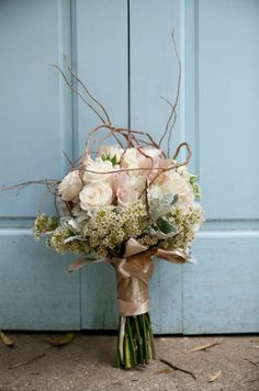 Pale pink roses, cream wax flower, curly willow, dusty miller $95