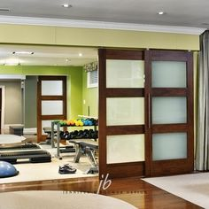 Home gym idea.....these type of doors to divide work out area and man cave Home Gyms - amzn.to/2hoGXRy Sports & Outdoors - Sports & Fitness - home gym - http://amzn.to/2jsMKm8