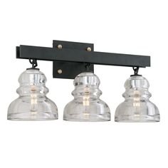 The Menlo Park 3-light Bath Sconce comes in a deep bronze finish and a clear shade.  This fixture is made of hand-worked iron and solid brass and historic pressed glass material.