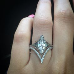 """A marquise mixed with trillions and a diamond """"V"""" band for the win! #diamondring #diamonds #engagementrings #trophywife"""