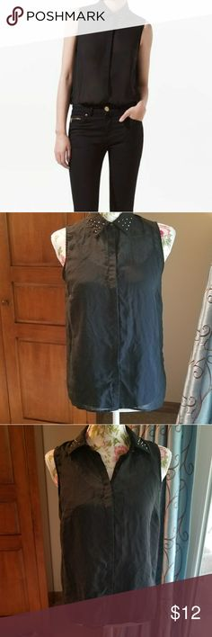 💙Zara Basic black sleeveless blouse, studded Lightweight black blouse. Most will probably want to wear a cami beneath, see pic 5. Front buttons, hidden placket. Top button looks like studs. Studs on collar, metallic black. Slight high-low hem. Pic 1 shows fit, rest are my top. Size S. Armpit to armpit approximately 17 inches. Approximately 26 inches long in back. Size chart pic 7. No fabric tag, but I believe it is polyester and have washed by hand. Slight wrinkles but in excellent used…