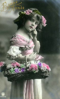Little girl with flowers ca. 1900