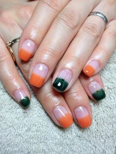 Green and orange tip nails