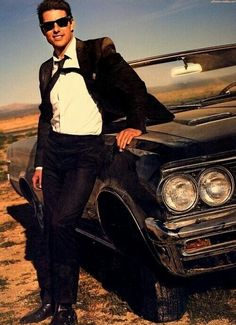 Tom Cruise...posing with a car