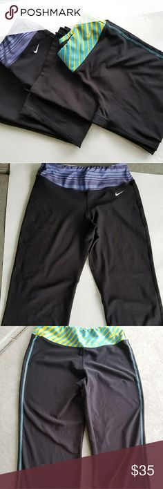 2 Pair of Nike Crop Pants Size Small And XS 2 Pair of Nike Crop Pants Size Small And XS. The blue and purple band ones are size xs and the yellow and blue are size small. Both in great condition only blemish is the inseam on the waist band of the blue ones has come loose. Super easy fix. Nike Pants Track Pants & Joggers