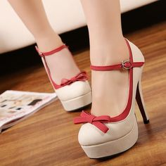 Cream/tan and red Mary Jane heels with bow and platform. Super cute!
