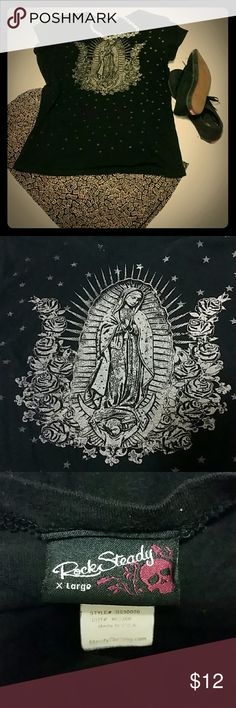 Virgen de Guadalupe tee La Virgen beautifully rendered in a soft taupe surrounded by roses and stars. Super soft tee and print. Women's XL, runs small. Rock Steady Tops Tees - Short Sleeve