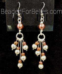 Crafted with tawny and silver beads and silver non-tarnish craft wire.     Go to http://BeadedForBelles.com to see more handcrafted pieces. Make sure to subscribe!     #beadedforbelles #b4b #handmade #handcrafted #jewelry #jewellry #dangle #earrings  #brown #orange  #tawny  #silver  #ladiesfashion #womensfashion   Shop this product here: http://spreesy.com/beadedforbelles/50   Shop all of our products at http://spreesy.com/beadedforbelles      Pinterest selling powered by Spreesy.com