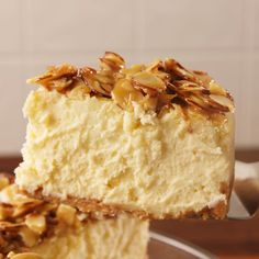 If you love almonds you need this cheesecake Get the recipe at delish easy recipe amaretto almond cheesecake dessert vanilla Just Desserts, Delicious Desserts, Dessert Recipes, Yummy Food, Vanilla Desserts, Summer Desserts, Healthy Desserts, Dessert Ideas, Amaretto Cheesecake