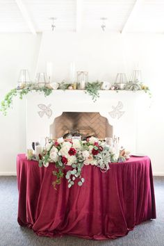 How to light wedding reception details • Wedding Photography Tips • Winter wedding head table with rich burgundy color tones and floral greenery