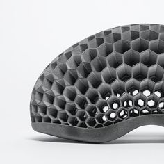 The worlds first custom-fit helmet. Built on a honeycomb structure that's safer than traditional foam helmets, each Hexr is crafted to the exact contours of the rider's head. Materials And Structures, 3d Pattern, Patterns, 3d Printer Designs, Two Heads, Material Science, Earth Design, Helmet Design, Industrial Design