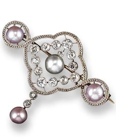 An Edwardian natural saltwater and freshwater pearl and diamond brooch. The centre button-shaped pearl set within a surround of circular-cut diamonds with further three pearls, mounted in platinum and gold. 4.5cm wide. #Edwardian #brooch