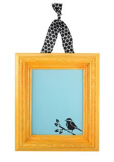 "Mats:  Open Back Frame, 8""x10""  Canvas Board, 8""x10""  Martha Stewart Crafts™ Chalkboard Paint – Blue  Martha Stewart Crafts™ Craft Paint – Beetle Black, Yellow Gold, Marmalade and Wedding Cake  Martha Stewart Crafts™ Stencil – Birds/Berries  Stencil Brush (or Pouncer)  Sponge Brush"