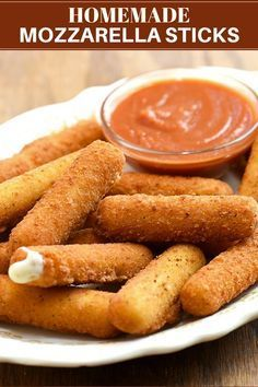 Breaded Mozzarella Sticks with Marinara Sauce Mozzarella cheese sticks with gooey, melty cheese and crisp, golden crust are the perfect appetizer for a party or game day. Served with homemade marinara sauce, they're seriously addicting! Fried Mozzarella Sticks Recipe, Fried Cheese Sticks, Homemade Mozzarella Sticks, Mozzarella Cheese Sticks, Homemade Marinara, Mozza Sticks, Mozzerella, Homemade Cheese Sticks, Cheese Sticks Recipe