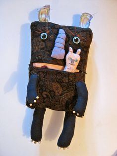 big monster doll is 18 inches tall The zipper works .opens and closes . you could put the little monster in his mouth can be hung on the wall or sit on a shelf hand made, zipper mouth original art doll by Sandy Mastroni { copyright }Thank you Ugly Dolls, Creepy Dolls, Cute Dolls, Zombie Dolls, Voodoo Dolls, Monster Toys, Monster Art, Cute Monsters, Doll Repaint