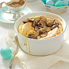 Cheese Grits Soufflé with Mushroom Gravy | Warm, sherry-laced mushroom gravy gives this simple grits soufflé an extra layer of depth. Gruyère cheese melts perfectly into the hot grits and adds subtle nutty flavor.