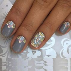 Grey Nail Lacquer with studded style mosaic nail designs