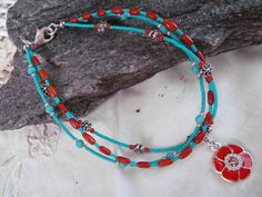 A personal favorite from my Etsy shop https://www.etsy.com/listing/107517405/turquoise-and-red-anklet
