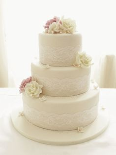 Round Wedding Cakes - Ivory roses and lace three tier wedding cake