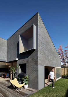 Modern Brick Home Design Brings Innovative Brick Architecture, Australian Architecture, Residential Architecture, Black Brick, Timber Deck, Melbourne House, Brick And Mortar, Modern House Design, Modern Brick House