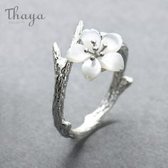 Treat yourself to the White Cherry Blossom Silver Ring or order one for a friend. Shop at the Apollo Box for handcrafted sterling silver jewelry. silver design White Cherry Blossom Silver Ring from Apollo Box Cute Jewelry, Charm Jewelry, Gold Jewelry, Glass Jewelry, Greek Jewelry, Gemstone Jewelry, Jewlery, Silver Bracelets, Sterling Silver Necklaces