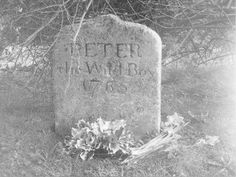 "Peter the Wild Boy - d. 1765"" a feral 12 yr old found in the German forest in 1725. Peter walked on all fours, ate grass & leaves and never learned to speak.He was bought to London and lived at the castle,virtually a ""pet"". He is buried in Hertfordshire,England."