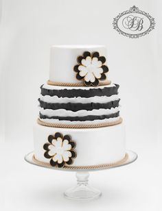 Pretty Navy Ruffles on White Cake with Flower Applique
