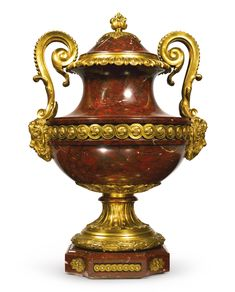 A large Louis XVI style gilt bronze mounted rouge griotte marble urn and cover France, circa 1880