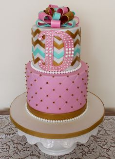 Zig Zag Chevron & diamond pattern + fondant bow, pearls and initial birthday cake. Serendipity Cakes by Olivia Girly Birthday Cakes, Fondant Bow, Pink Turquoise, Diamond Pattern, Serendipity, Zig Zag, Chevron, Initials, Bakery