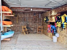 Cottage Vacation Rental - Wraight Escape - Garage by waterfront with boats, lifejackets, etc.