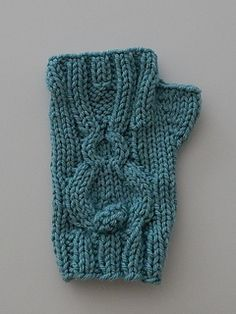This bunny mitten pattern has an adorable cable bunny with long ears and a big bobble tail. The bunny is surrounded by a Stockinette stitch. These mittens are knit in the round and have an abbreviated thumb gusset. The gusset is knit as part of the mitten and does not require putting stitches on a holding needle.