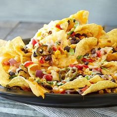 Grilled Loaded Nachos from The Pampered Chef on the grill stone rockcrok. Follow me on FB https://www.facebook.com/CookingwithYvette/