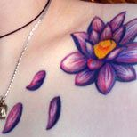 Purple lotus tattoo on a girl's shoulder